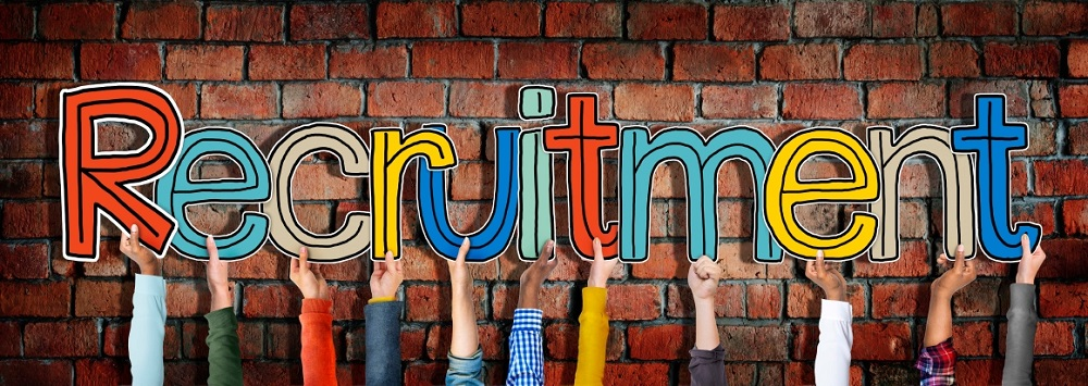 Group of Diverse People's Hands Holding Recruitment